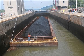 A barge laden with coal moves into a lock at Emsworth on the Ohio River. Xcoal of Latrobe has reached an agreement to supply coal to Ukraine.
