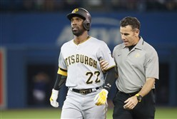 Andrew McCutchen leaves with a left leg injury in the third inning Friday night against Toronto.