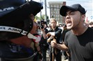 "White nationalists, neo-Nazis and members of the ""alt-right"" exchange insults with counter-protesters as they enter Lee Park during the ""Unite the Right"" rally Saturday in Charlottesville, Virginia."