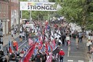 "Hundreds of white nationalists, neo-Nazis and members of the ""alt-right"" march down East Market Street toward Lee Park during the ""Unite the Right"" rally Saturday in Charlottesville, Va."