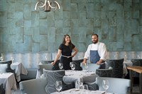 Vanessa Cominsky, assistant general manager and sommelier, and Andrew Garbarino, chef and owner, in the upstairs dining room of the Twisted Frenchman in East Liberty.