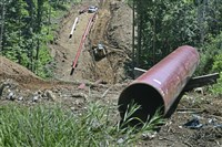 Workers install a natural gas pipeline for Rover Pipeline LLP on July 26 near the New Vrindaban community in Moundsville, W.Va.