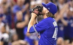 Blue Jays starting pitcher Chris Rowley reacts after being pulled from the game, having given up a single run, in the sixth inning.