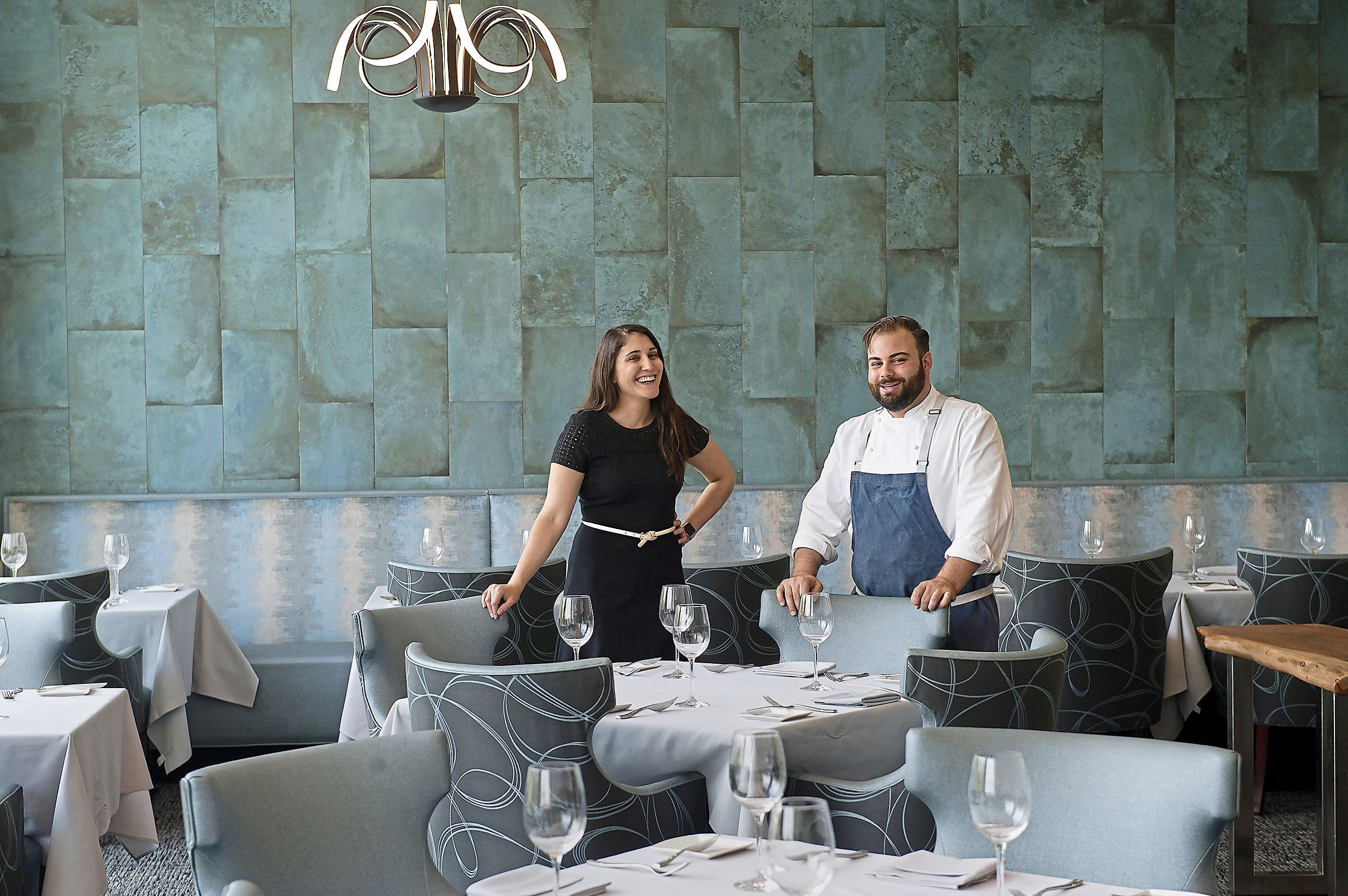 20170811rldTwistedFrenchman03-2 Vanessa Cominsky, assistant general manager and sommelier, and Andrew Garbarino, chef and owner, in the upstairs dining room of the Twisted Frenchman in East Liberty.