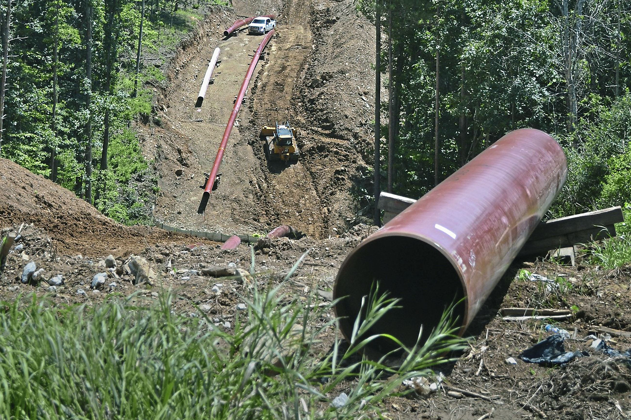 new vrindaban gas 2-4 Workers install a natural gas pipeline for Rover Pipeline LLP on July 26 near the New Vrindaban community in Moundsville, W.Va.