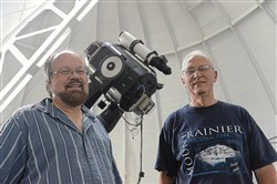 David Turnshek, left, professor of physics and astronomy at the University of Pittsburgh, and long-time friend Ed Potosky at the Allegheny Observatory in Observatory Hill on the North Side. The men, who as teenagers traveled together to Virginia Beach, Va., to view the total solar eclipse in 1970, will travel to Tennessee to study and document Monday's total solar eclipse.
