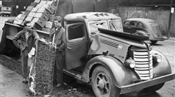 From The Digs -- James Alucci and his brother-in-law Stanley Nasiatka of Waynesburg examine the cargo from their destroyed truck. Photo published Nov. 25, 1946.