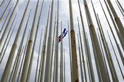 In this 2016 file photo, a lone Cuban flag waves among empty flag poles near the U.S. Embassy in Havana.
