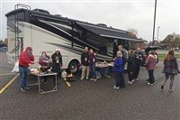 Barton and Penney Buxton tailgate with family and friends around their 36-foot-long Tiffin Allegro RV at Saginaw Valley State University in Michigan.