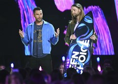 Adam Levine, left, and James Valentine of Maroon 5 accept the Decade Award at the Teen Choice Awards at the Galen Center on Sunday.