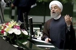 Iranian President Hassan Rouhani (C)addresses the parliament in Tehran on August 15, 2017.  Rouhani warned that Iran could abandon its 2015 nuclear deal with world powers within hours if the United States keeps on imposing new sanctions as he outlined plans for his new term. / AFP PHOTO / ATTA KENAREATTA KENARE/AFP/Getty Images