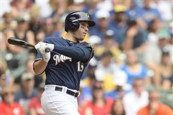 Neil Walker gets a base hit for the Brewers in a game against the Reds Sunday at Miller Park.