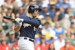 Neil Walker of the Milwaukee Brewers gets a base hit during the first inning against the Cincinnati Reds at Miller Park on Sunday.