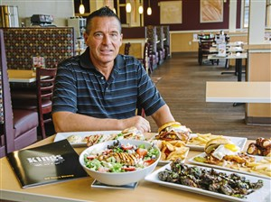 Tony Egizio, Director of Food & Beverage at Kings Family Restaurants, with new menu items at a Kings Restaurant on Tuesday in North Versailles.