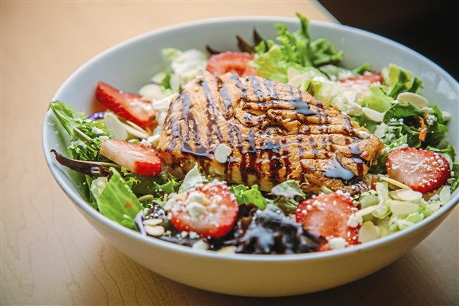 A grilled salmon strawberry salad