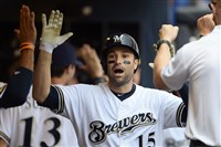 Neil Walker is congratulated by his Brewers teammates following a two-run home run during the third inning Wednesday at Miller Park.