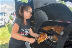 Stacy Bradley, 25, of Baldwin Borough smokes whole chickens.