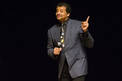 Astrophysicist Neil deGrasse Tyson presents a lecture March 21 at the Morris Performing Arts Center in South Bend, Ind. Mr. Tyson has a suggestion for anyone with a view of next week's solar eclipse: Put down your smartphone and experience the phenomenon in the moment.