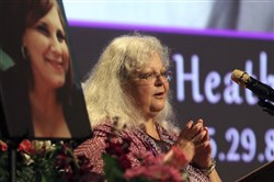 Susan Bro, mother to Heather Heyer, speaks during a memorial for her daughter, Wednesday at the Paramount Theater in Charlottesville, Va.