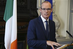 Ireland's Foreign Affairs Minister, Simon Coveney, speaks to the media at Iveagh House in Dublin in response to the U.K. Government's Brexit proposals Wednesday.