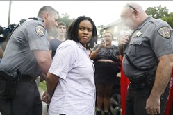 This framegrab from a video shows Takiyah Thompson, a member of Workers World Party and student at N.C. Central University, being arrested by Durham County Sheriff's deputies Tuesday in Durham, N.C.