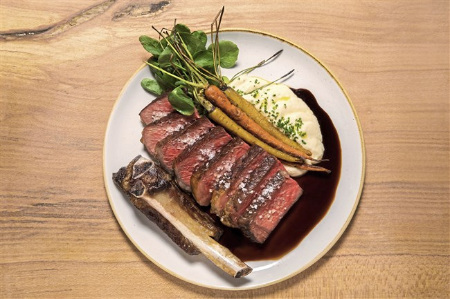 Rib-eye with peas, carrots, marrow, borscht and red wine sauce is on Acorn's menu.