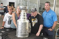 Penguins coach Mike Sullivan, right, poses for a picture with the Stanley Cup alongside his family.