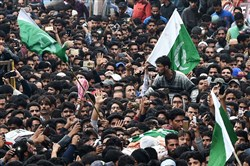 Indian Kashmiris shout slogans during the funeral procession for rebel commander of Hizbul Mujahideen, Yasin Yatoo, at the Nagam Chadoora Budgam district of Srinagar on July 14.