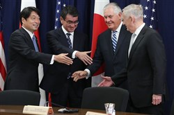 Secretary of State Rex Tillerson (second right) and Defense Secretary James Mattis (right) shake hands with Japanese Foreign Minister Taro Kono (second left) and Defense Minister Itsunori Onodera (left) during a meeting of the U.S.-Japan Security Consultative Committee at the State Department on Thursday in Washington.