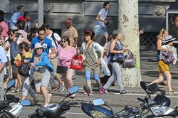 People run for their lives in Barcelona, Spain, on Thursday after a van jumped the sidewalk in the historic Las Ramblas district, crashing into a summer crowd of residents and tourists, killing at least 13 and injuring more than 100, police said.