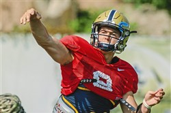 Freshman quarterback Kenny Pickett was working with Pitt's backup offense Tuesday morning at practice, as expected.