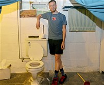 Ted Zellers stands beside a genuine Pittsburgh potty in the basement of a friends home in Morningside.