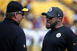Steelers defensive coordinator Keith Butler, left, talks with head coach Mike Tomlin before a Steelers-49ers game in 2015 at Heinz Field.