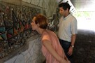 Brittany Reilly and Will Zavala study Virgil Cantini's mosaic mural in a Downtown pedestrian tunnel.