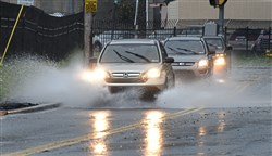 Police say rain may have played a role in several Friday moring accidents on Pittsburgh area roadways. Above, motorists make their way to work along Becks Run Road in Baldwin Borough.