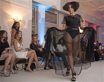 A model struts down the runway in an Elaine Healy design at the Style Week Pittsburgh kick off fashion show on Thursday, August 17, 2017, at Coterie Pittsburgh, Downtown.