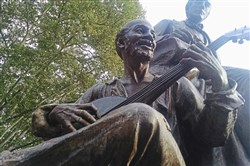 Statue of 19th-century American songwriter and Pittsburgh native Stephen Foster, depicted with an African-American musician. It was once located in Highland Park, but is now in Oakland.