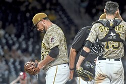 Pirates reliever Joaquin Benoit walks to the dugout after being taken out of the game against the Cardinals in the seventh inning Thursday.