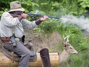 """Dan Anderson, also known as """"Dirt Slider,"""" from North Washington, shoots from a saddle at a Logan's Ferry Regulator Cowboy Action Shooting Competition at Logan's Ferry Sportsman's Club in New Kensington."""