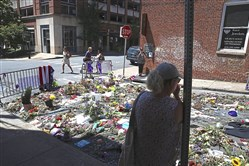 Flowers cover the street Friday in Charlottesville, Va., where Heather Heyer was killed and 19 others injured when a car slammed into a crowd protesting against a white supremacist rally.