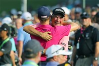 Justin Thomas (back to camera) hugs his father Mike Thomas after winning the 2017 PGA Championship Aug. 13 at Quail Hollow Club in Charlotte, N.C.