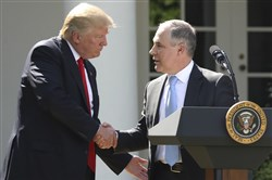 In this June 1 file photo, President Donald Trump shakes hands with EPA Administrator Scott Pruitt after speaking about the U.S. role in the Paris climate change accord in the Rose Garden of the White House in Washington.
