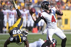 Steelers inside linebacker Vince Williams tumbles as he rushes Atlanta Falcons quarterback Matt Simms in the first half Sunday at Heinz Field.