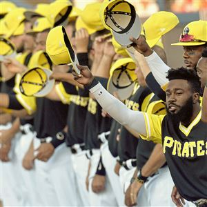 Pirates teammates tip their caps the the Little League players before the start of the MLB Little League Classic at Bowman Field Sunday, August 20, 2017 in Williamsport.