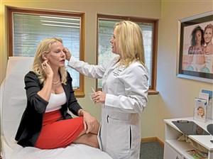 Lela Covey discusses the treatment she will be receiving with Debbie Thompson, RN, during an appointment at the Skin Center Med Spa in Mt. Lebanon.