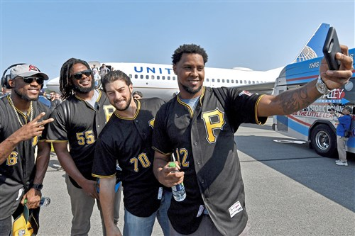 Pirates Starling Marte, Josh Bell, George Kontos and Juan Nicasio take a selfie as the team arrives at the Williamsport Airport Sunday.