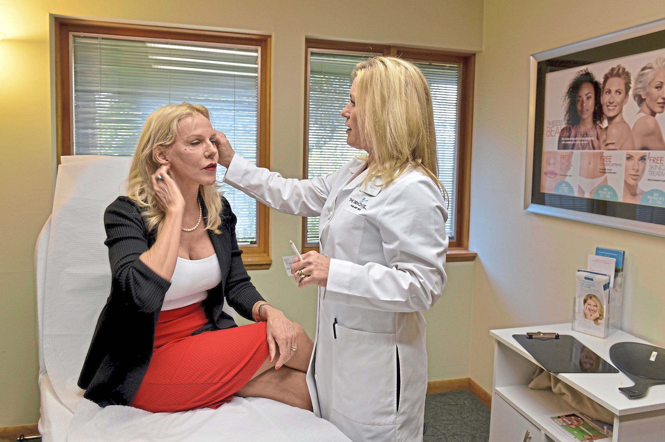 20170802ppCosmeticSurgery1NEXT_001 Lela Covey discusses the treatment she will be receiving with Debbie Thompson, RN, during an appointment at the Skin Center Med Spa in Mt. Lebanon.