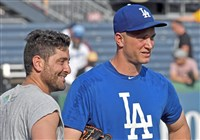 Pirates catcher Francisco Cervelli talks with Dodgers reliever Tony Watson before the teams played Monday at PNC Park.
