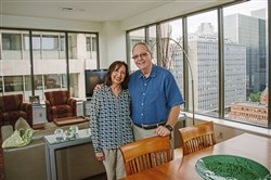 Sam and Gracie Harris, former Michigan residents photographed in their 151 First Side condominium unit Downtown, are among recent retirees who extol the city's virtues.