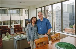 Sam and Gracie Harris in their condo unit at First Side condominiums, Downtown..